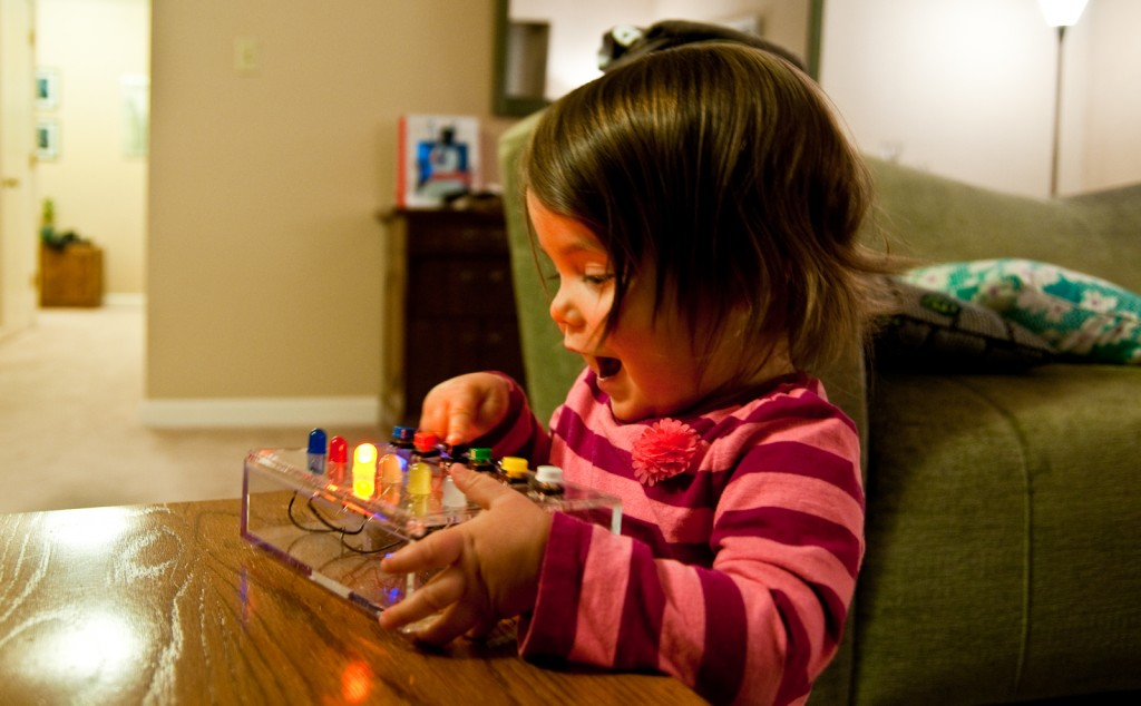 Child plays with LED Button Box toy