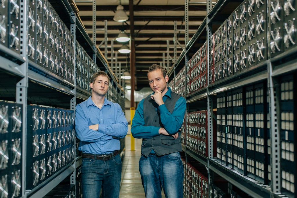 Garza standing in a datacenter full of digital currency mining hardware